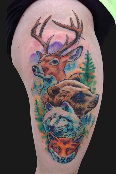 animal tattoo that represents family animal family watercolor tattoo by jamie lee parker