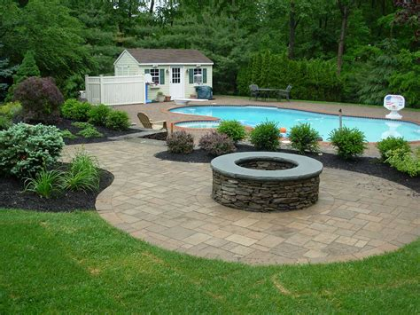 firepit in backyard outdoor kitchens pits green landscaping