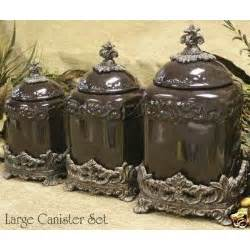 Brown Kitchen Canister Sets Large Canister Set Of 3 Brown Canisters In Base Thisnext