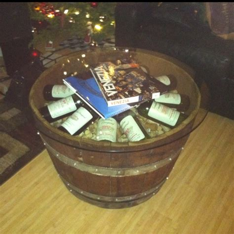 wine barrel coffee table with corks and wine