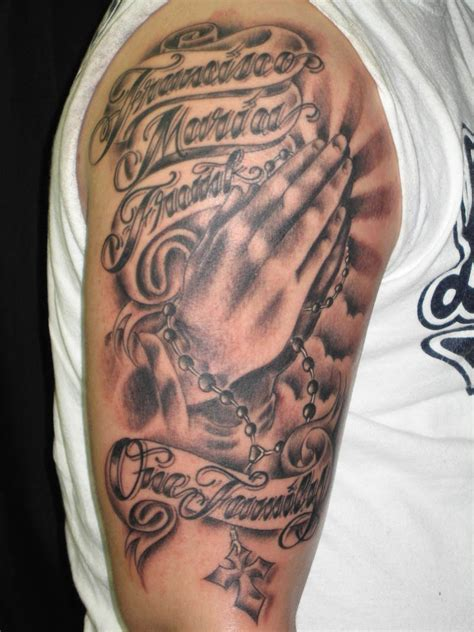 half sleeve tattoo with cross grey ink praying cross rosary on right half