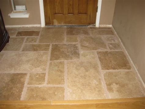 tile floor and decor once upon a cedar house installing travertine tile in the kitchen part 1