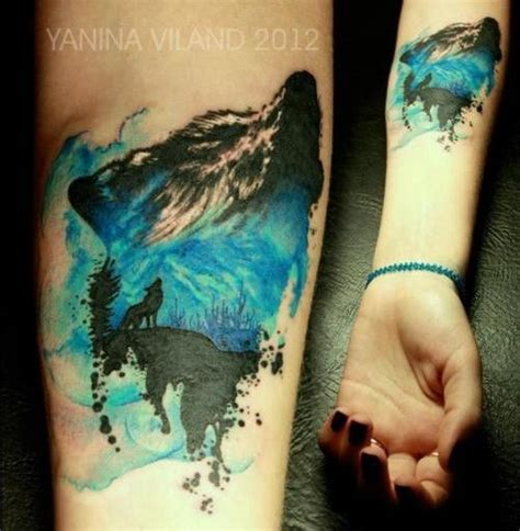 black and blue tattoo blue and black wolf on arm tattoomagz