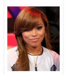 a side part with hair and a swoop and a cross lauren london inspired full sew in with swooped side bang