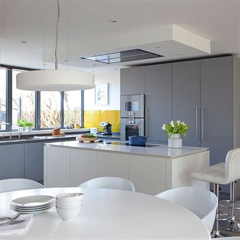 white and gray kitchen ideas grey kitchen with white island and yellow splashback