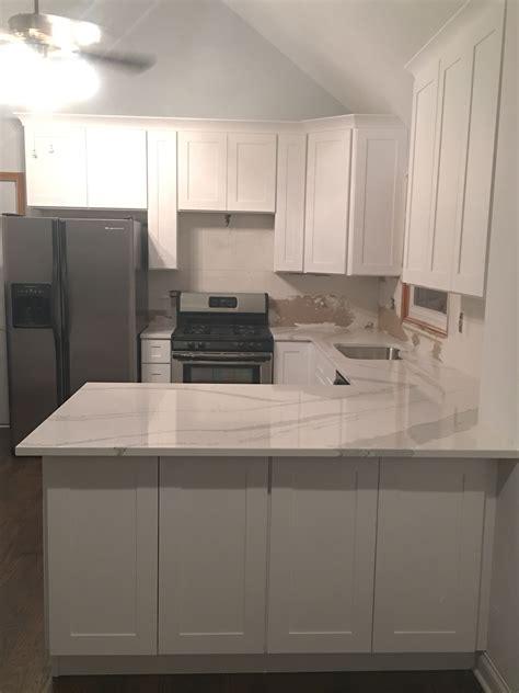 white shaker cabinets with quartz countertops kitchen renovation all white cabinets with quartz