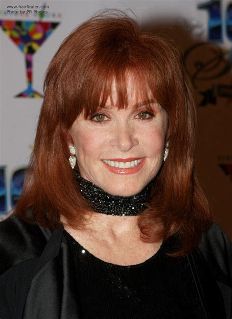 Stefanie Powers with red colored hair and spacey bangs