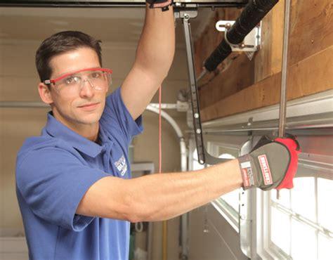 Garage Door Technician by Garage Door Repair Springs Openers Cables