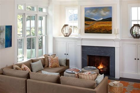 family room with sectional and fireplace designer tips for cozying up your living room hgtv