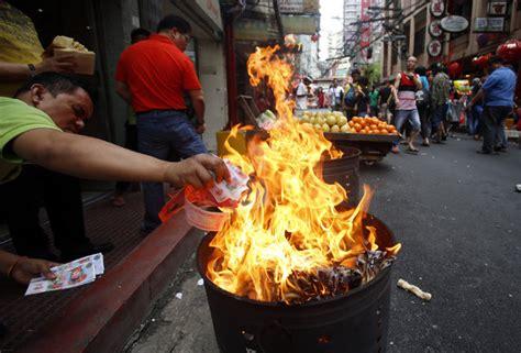 burning money on new year year of the monkey celebrations