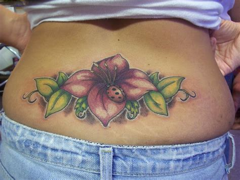 100 s of lower back tattoos for women design ideas