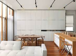 Those same plain white cabinets can be lined up and affixed to the