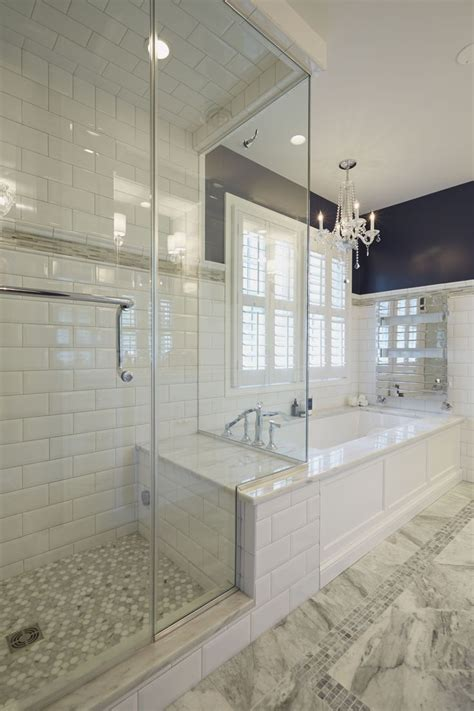 Bathroom With Shower And Tub Glass Enclosed Shower With Bench Connected To The Platform Of A Soaking Tub With Heated Towel