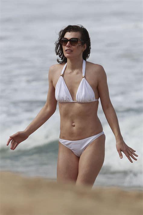 milla jovovich hawaii film milla jovovich in white bikini in hawaii celebrity archive