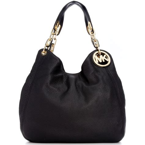 Michael Kors Fulton Lunggage michael kors fulton large shoulder tote in gold luggage lyst