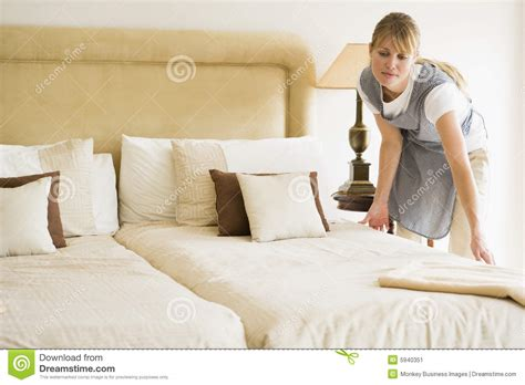 bed making maid making bed in hotel room stock image image 5940351