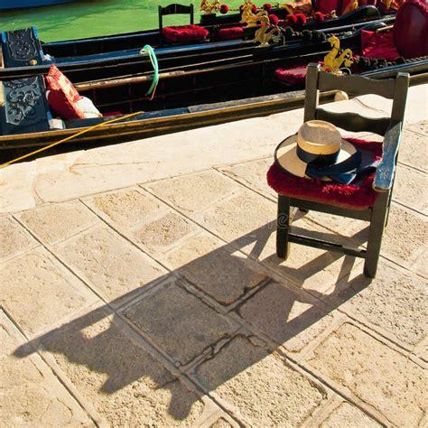 gondola boat driver gondola driver waiting chair at venice italy stock photo