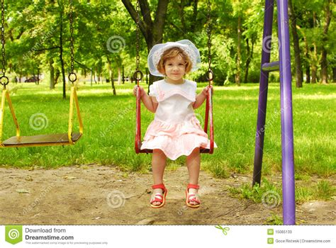 sitting swing little girl sitting on the swing stock image image 15065133