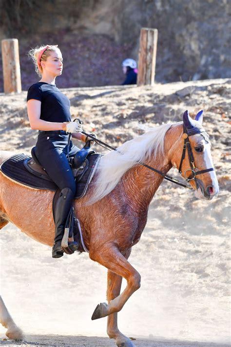 amber heard horse riding  celebmafia