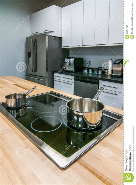 stove to table cookware kitchen butcher table island with stove top and pans stock
