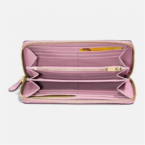 Pink Wallet coach accordion zip wallet in signature embossed leather in pink lyst