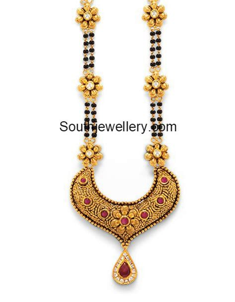 black mangalsutra with gold pendant jewelry