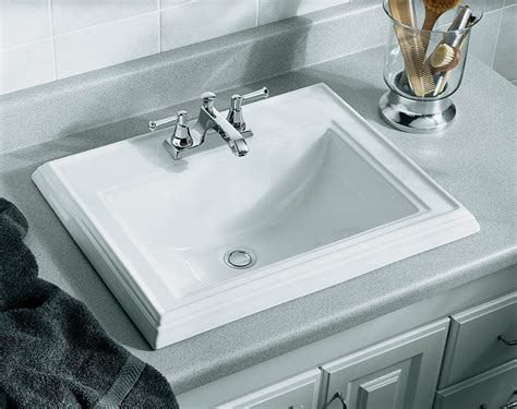how to install drop in bathroom sink faucet k 2241 4 47 in almond kohler drop in bathroom sink