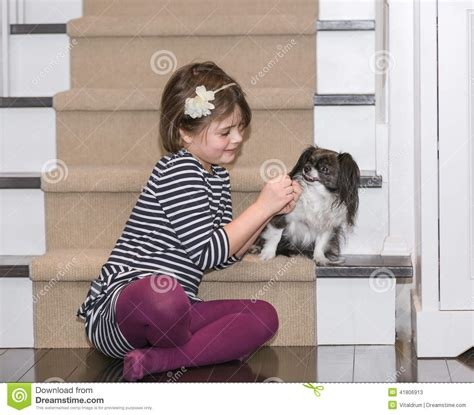dog and child near my house a child play with a dog inside the house stock photo image 41806913