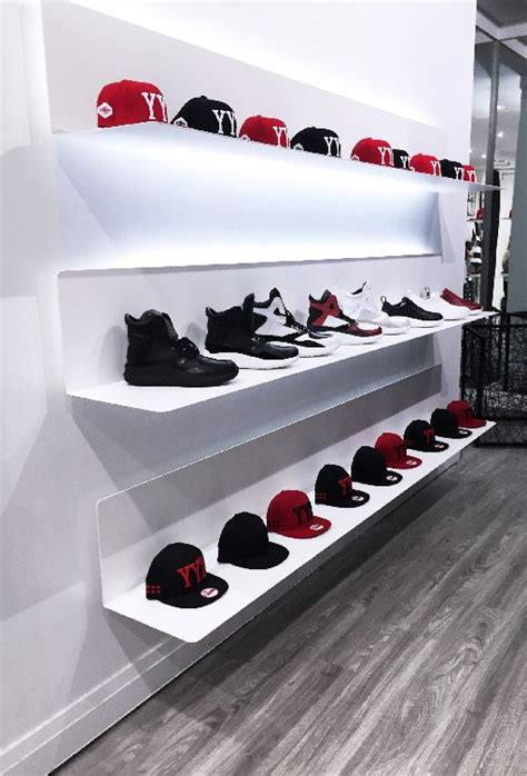 25 best ideas about shoe display on shoe wall