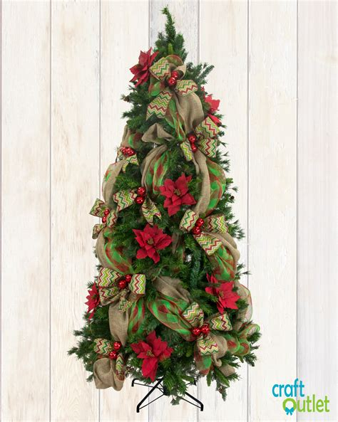 adding deco mesh last minute to xmas tree tree decorating with burlap and deco mesh craft outlet inspiration