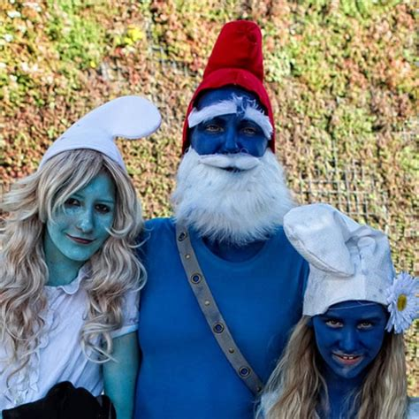 people wearing smurfs costumes popsugar beauty