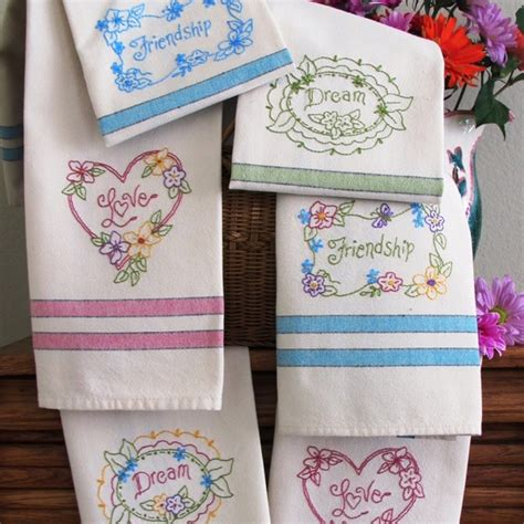 machine embroidery designs for kitchen towels pretty flowers hand embroided on bright tea towels
