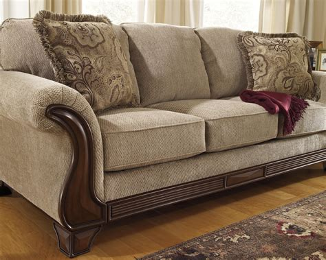 sofa  flared arms faux wood accents  signature design  ashley wolf furniture