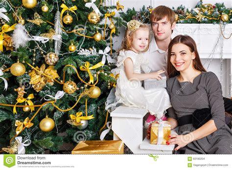 family christmas tree jarrettsville family near the tree and gifts stock photo image 63190204