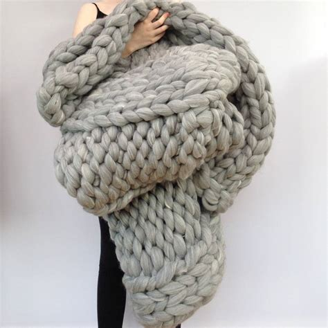 chunky knit knitted chunky blanket by wool couture