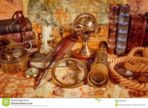 Piring Antik Vintage Zaman Doeloe vintage magnifying glass lies on an ancient world map stock photo image 60626983