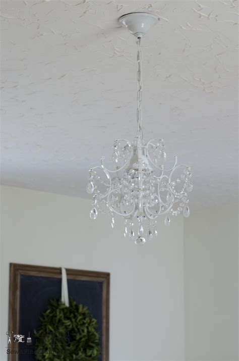 a chandelier and a cow hide rug sew a fine seam a chandelier and a cow hide rug sew a fine seam