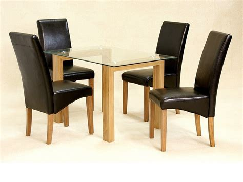 Brown Dining Table And Chairs Rectangle Glass Top Table With Light Brown Wooden Legs Combined With Black Leather Chairs Plus