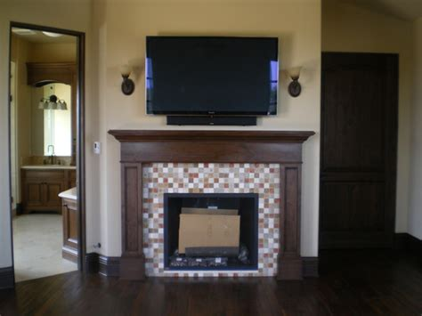 mosaic tile fireplace surround mediterranean bedroom