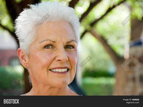 what causes 60 year old female to have thinning hair beautiful 55 60 year old woman image photo bigstock