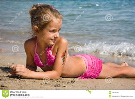 rainpow young little girls young girl at the beach stock photo image of outdoors