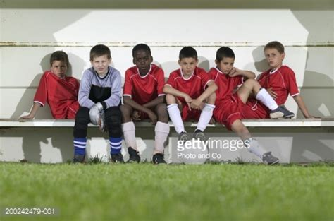 team bench soccer football team of boys sitting on bench portrait stock