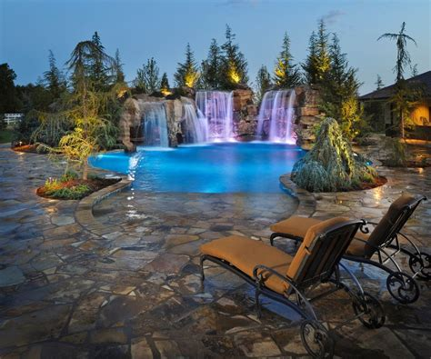 Malibu Led Low Voltage Landscape Lighting - rustic swimming pool with fountain by caviness landscape design zillow digs