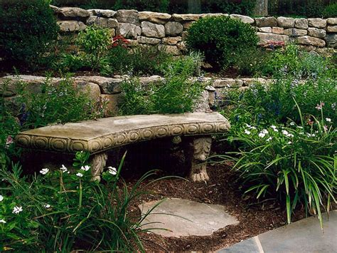 stone retaining wall with curved stone bench traditional