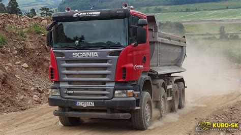 scania r420 dump truck driving at the quarry