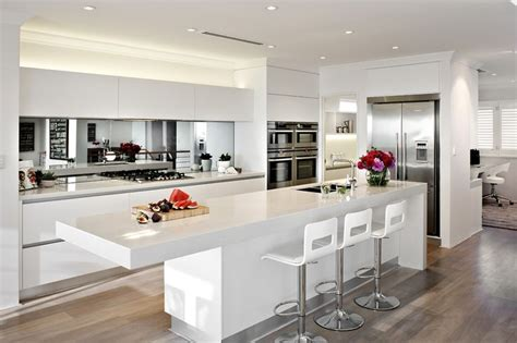 mirror backsplash kitchen mirrored splashback helps make the room look bigger http