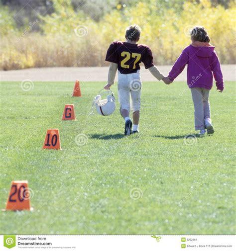 little league football players little league football player and girlfriend stock image