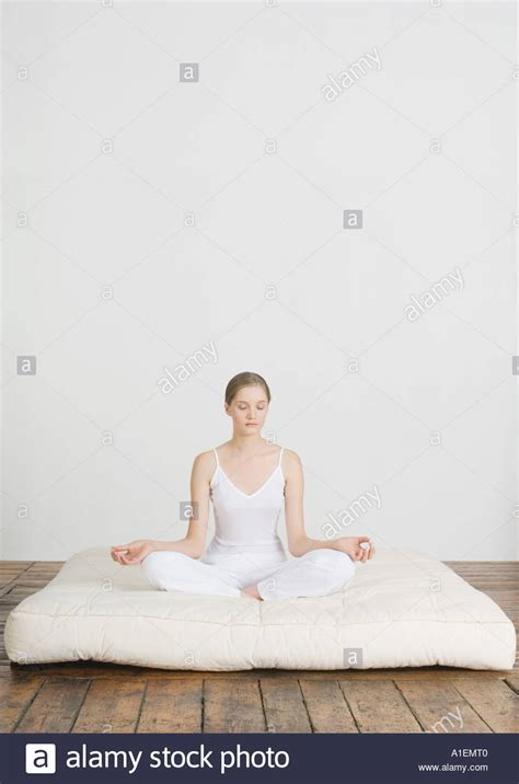 lotus position in bed young woman sitting in lotus position on futon mattress