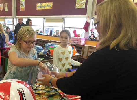 erie church gives gifts to grover cleveland students