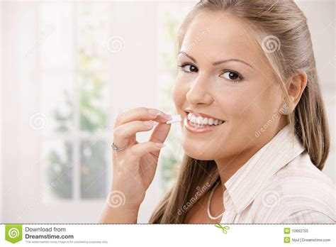 eats gum beautiful chewing gum royalty free stock photo image 10662755